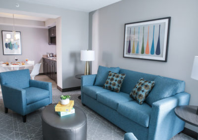 Suite room at the Rewind Hotel with couches and chair